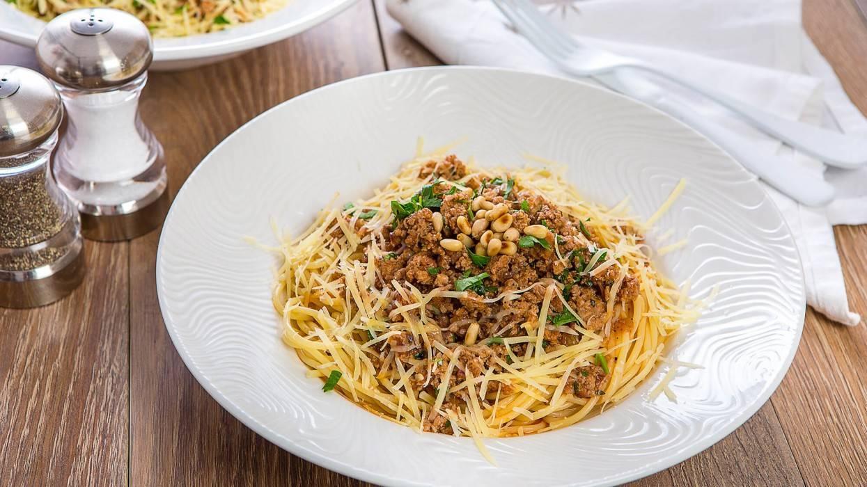 Паста фарфалле с кедровыми орешками, печеным чесноком, сыром и каперсами - кулинарный рецепт с пошаговыми инструкциями   foodini